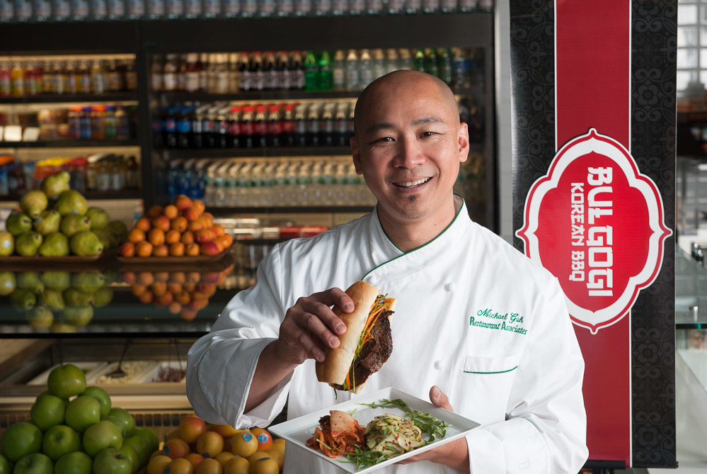 restaurant associates chef with sandwich